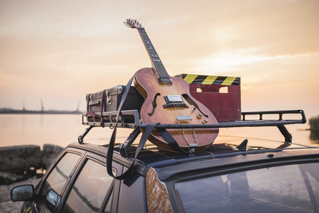 Photo for Music instrumental guitar car outdoor background - Royalty Free Image