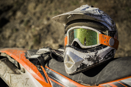 Photo for Dirty motorcycle motocross helmet with goggles - Royalty Free Image