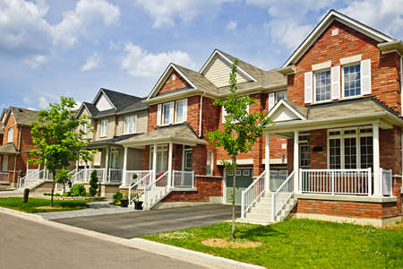 Photo for Suburban residential street with row of red brick houses - Royalty Free Image