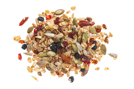 Photo for Pile of homemade granola with various seeds and berries shot from above isolated on white background - Royalty Free Image