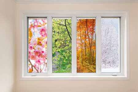 Photo pour Window in home interior with view of four seasons - image libre de droit