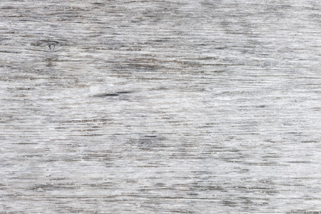 Photo pour Gray wooden background of weathered distressed unpainted rustic wood showing woodgrain texture - image libre de droit