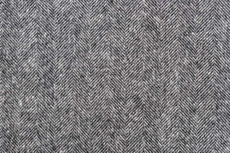 Photo pour Herringbone tweed background with closeup on wool fabric texture - image libre de droit