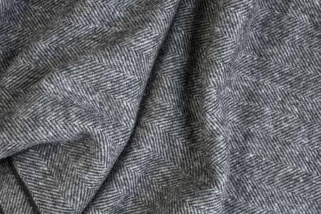 Foto de Draped herringbone tweed background with closeup on wool fabric texture - Imagen libre de derechos