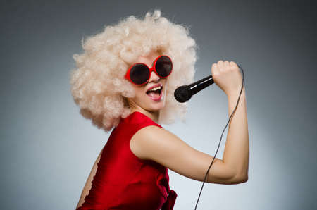 Photo for Young woman with mic in music concept - Royalty Free Image