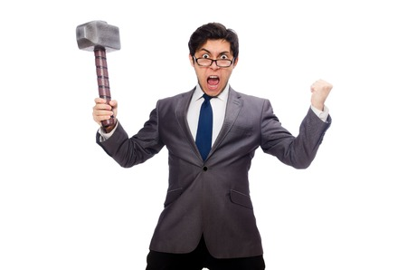 Photo pour Business man holding hammer isolated on white - image libre de droit
