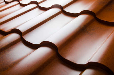 Foto de Close up of metal roof tile - Imagen libre de derechos