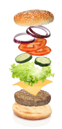 Photo pour Flying ingredients of hamburger isolated on white - image libre de droit
