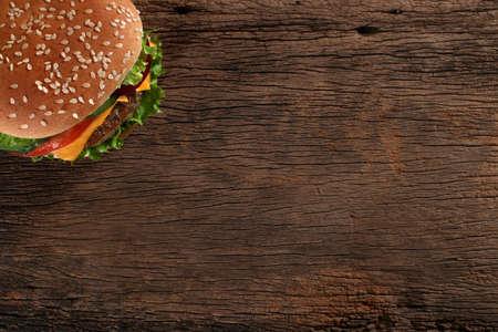 Photo pour Tasty hamburger on wood background  Space for text - image libre de droit