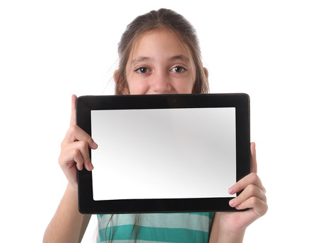Photo pour Beautiful preteen girl with a tablet computer. Isolated. Clipping path for the screen - image libre de droit