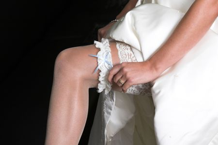 Bride pulling up her stockings showing a sexy leg