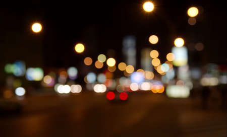 Out of focus lights of urban traffic in a city