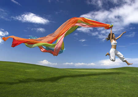 Foto für Young beautiful woman jumping with a scarf - Lizenzfreies Bild