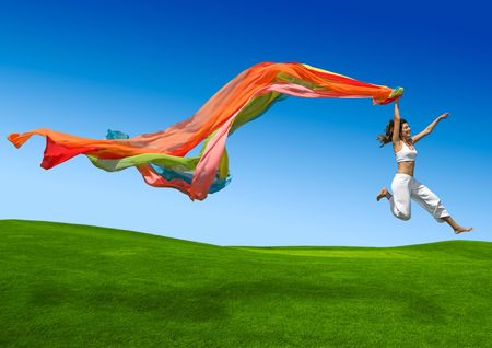 Foto de Young beautiful woman jumping with a scarf - Imagen libre de derechos
