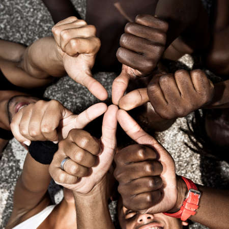 Photo for A group of mixed race people with hands doing thumbs up - Royalty Free Image