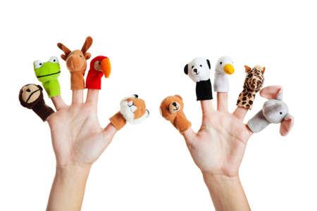 Photo for Female hand wearing 10 finger puppets; monkey, frog, reindeer, parrot; lion; bear; panda; duck; giraffe; elephant  - Royalty Free Image