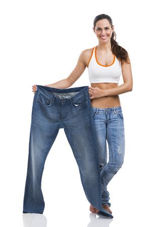 Foto de Woman with large jeans in dieting concept - Imagen libre de derechos