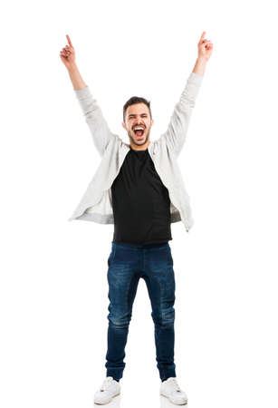 Photo pour Successful young latin man with arms up - image libre de droit