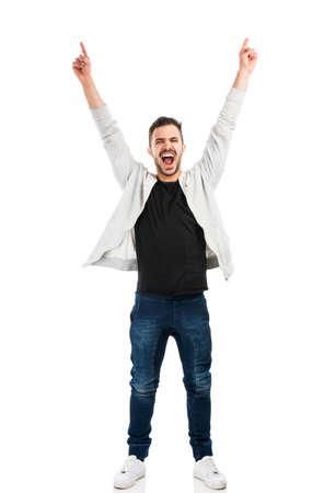 Foto de Successful young latin man with arms up - Imagen libre de derechos