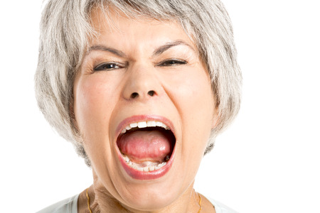 Foto per Portrait of a elderly woman with a yelling expression - Immagine Royalty Free