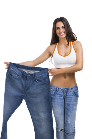 Foto de Woman with large jeans in dieting concept - Imagen libre de derechos