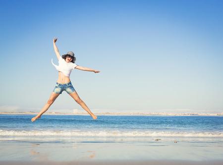 Photo for Beautiful young woman enjoying the beach - Royalty Free Image