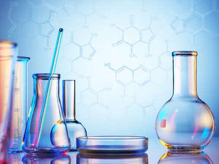 Foto de Laboratory glassware on color background - Imagen libre de derechos