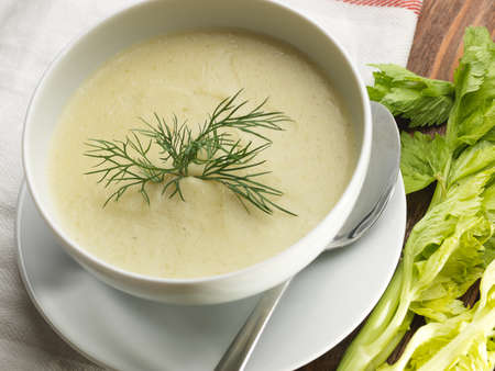 Photo for Top view of a bowl of celery soup on a rustic background. Close up - Royalty Free Image