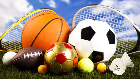Assorted sports equipment and grass
