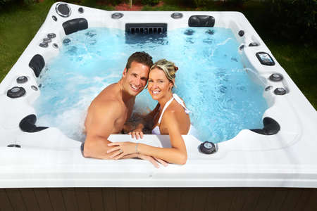 Photo for Happy couple relaxing in hot tub. Vacation. - Royalty Free Image