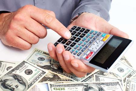 Foto de Hand with a calculator. Money saving concept. - Imagen libre de derechos