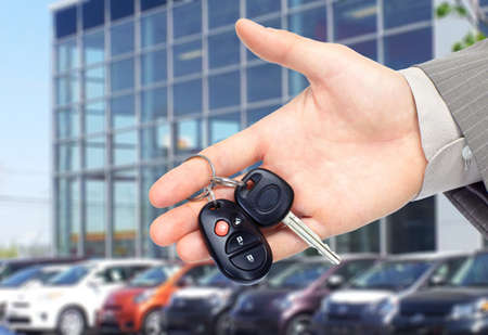 Photo pour Hand giving a car key. Auto repair service. - image libre de droit
