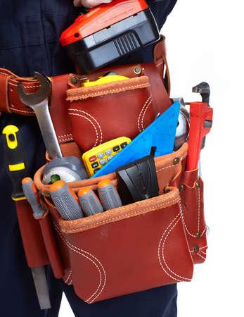 Foto de Handyman with a tool belt. Isolated on white background. - Imagen libre de derechos