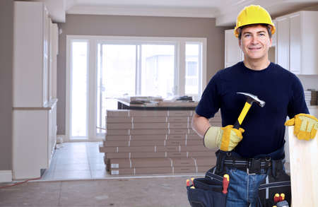 Photo pour Handyman with a tool belt. House renovation service. - image libre de droit