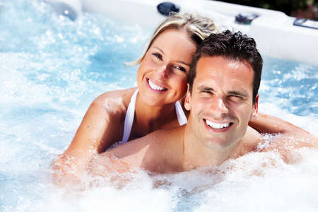 Photo for Happy couple relaxing in hot tub  Vacation  - Royalty Free Image