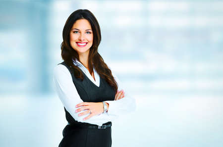 Photo pour Young bussiness woman standing over office background - image libre de droit