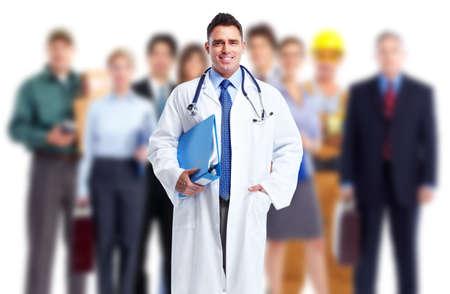 Foto de Doctor and a group of workers. Job safety. - Imagen libre de derechos