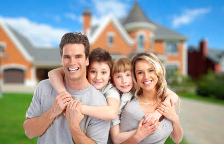 Photo pour Happy family near new home  Real estate background  - image libre de droit