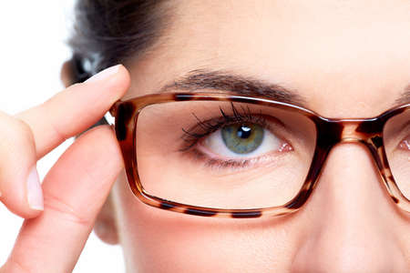 Foto de Eyeglasses. Woman wearing eyeglasses. Optometrist background. - Imagen libre de derechos