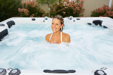 Photo for Beautiful woman relaxing in a hot tub. Vacation. - Royalty Free Image