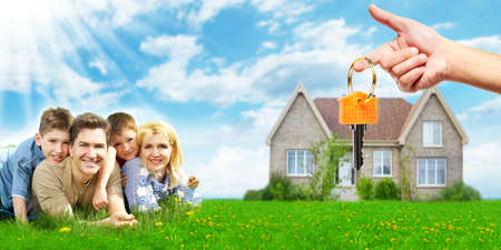 Photo pour Happy family near new home. - image libre de droit