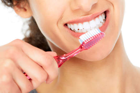 Photo pour Woman with toothbrush. - image libre de droit