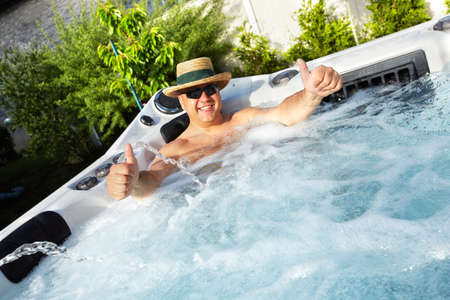 Photo for Man having massage in  hot tub spa. - Royalty Free Image