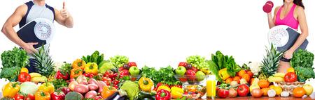 Photo pour Woman with scales fruits and vegetables background - image libre de droit