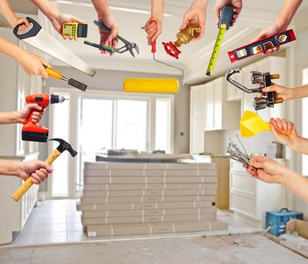 Photo pour Hands with construction tools. - image libre de droit