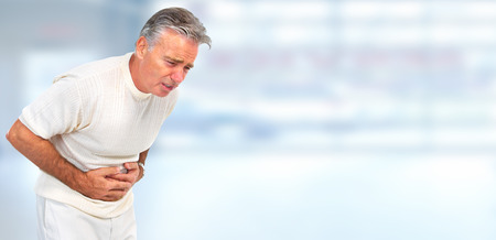 Photo for Man having a stomach ache - Royalty Free Image
