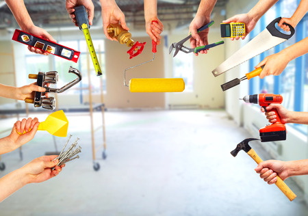 Foto de Hands with construction tools. - Imagen libre de derechos