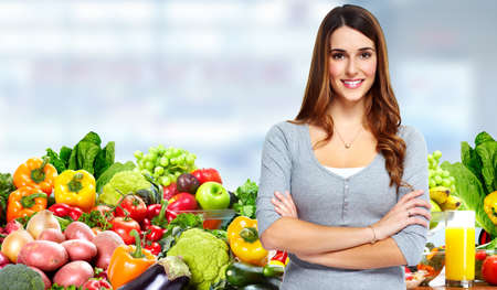 Photo pour Woman with fruits and vegetables. - image libre de droit