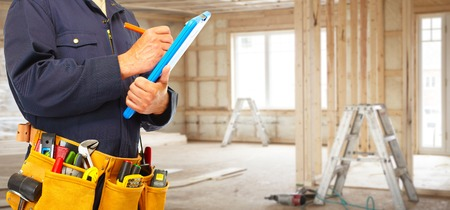 Foto de Builder handyman with construction tools. - Imagen libre de derechos