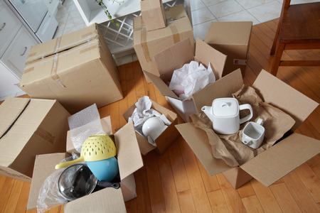 Foto per Moving boxes in new house. - Immagine Royalty Free